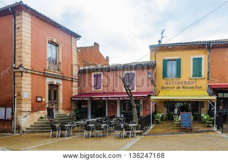 ROUSSILLON, FRANCE - DECEMBER 6, 2015: Small square in the hilltop village of Rousillon Provence France