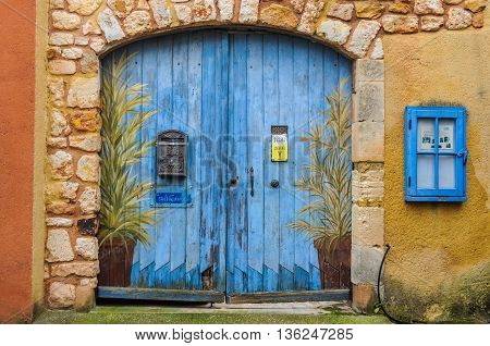 ROUSSILLON, FRANCE - DECEMBER 6, 2015: Blue door in the hilltop village of Rousillon Provence France