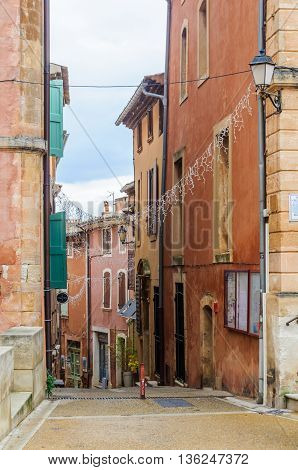 ROUSSILLON, FRANCE - DECEMBER 6, 2015: Colorful streets in the hilltop village of Rousillon Provence France