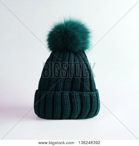 green Knitted hat with bubo over white