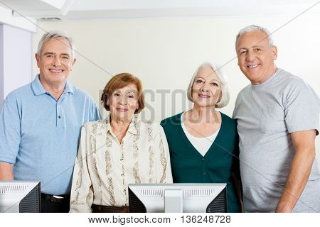 Happy Senior People In Computer Class