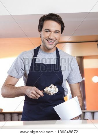 Waiter With Butterscotch Ice Cream And Cup At Parlor