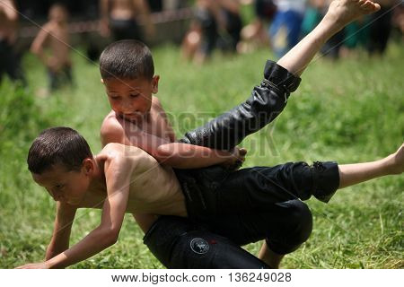 BURSA,TURKEY-MAY 13: Unidentified wrestlers participate in the annual oil wrestling championship on May 13,2012 in Bursa.Oil wrestling is considered as an ancestral sport in Turkey.