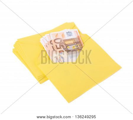 Stack of multiple yellow letter envelopes with the money inside of it, composition isolated over the white background