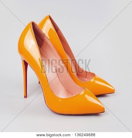 Yellow high heels shoes isolated on white