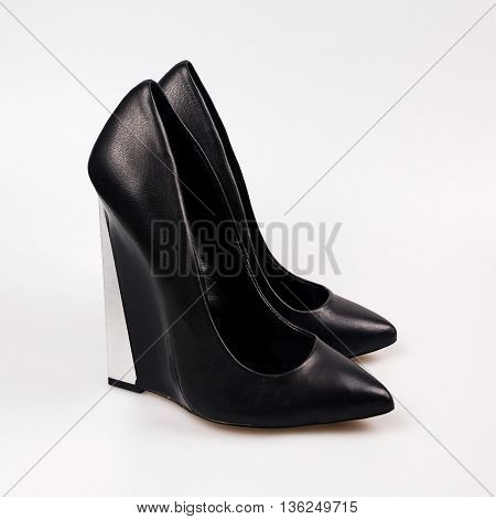 black female shoes in a white background