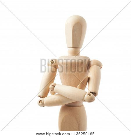 Made of wood human doll puppet statuette with its hands crossed, composition isolated over the white background