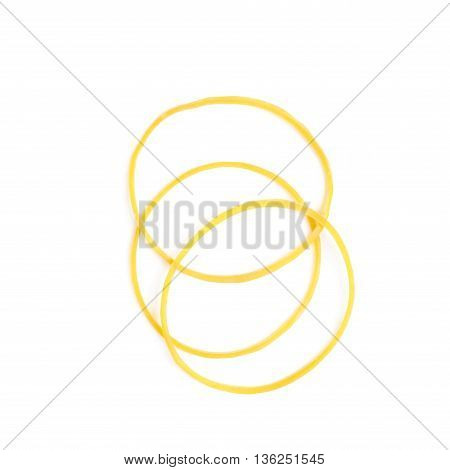 Few yellow office rubber bands, composition isolated over the white background