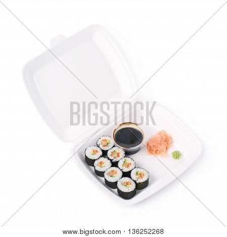 Set of sushi rolls served in a delivery container package, composition isolated over the white background