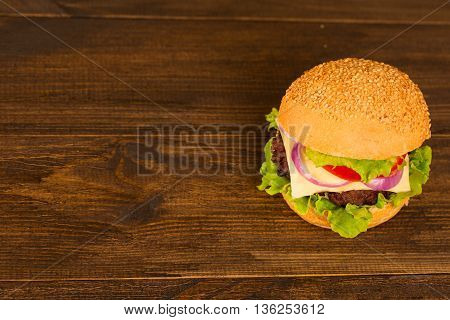 Top view bbq hamburger on the wooden background