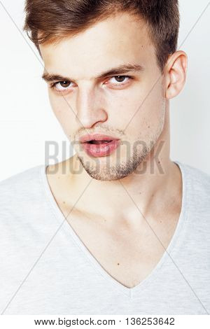 young handsome man on white background gesturing, pointing, posing emotional, cute guy sexy isolated