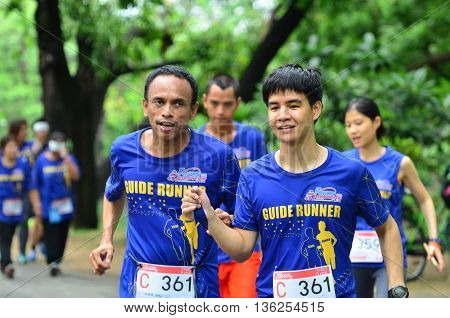 BANGKOK - JUNE 26 : Unidentified marathon runner at Run For The Blind # 2 Helping the blind to be able to run like normal person on June 26 2016 Bangkok Thailand.