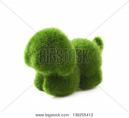 Puppy toy statuette made of plastic green grass as a Easter day decoration isolated over the white background