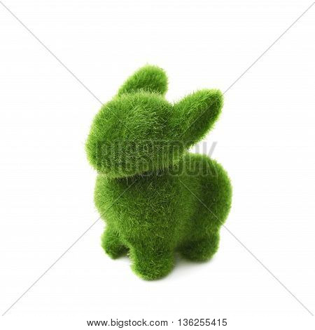 Bunny toy statuette made of plastic green grass as a Easter day decoration isolated over the white background
