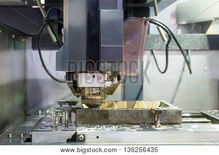 Industrial machine - EDM Industrial machine working with coolant injection in factory. Close up at Industrial machine.