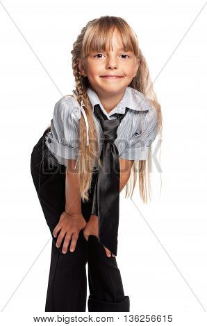 Happy schoolgirl posing isolated on white background. Back to school concept.