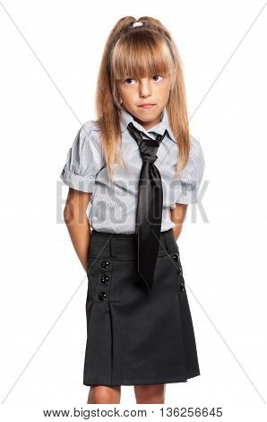 Unhappy schoolgirl posing isolated on white background. Back to school concept.