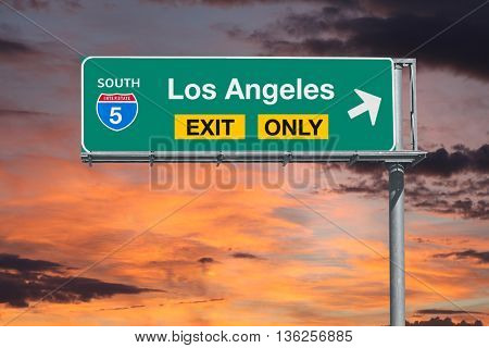 Los Angeles exit only 5 freeway sign with sunrise sky.
