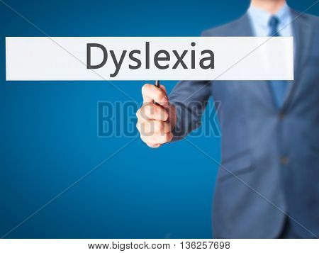 Dyslexia - Businessman Hand Holding Sign