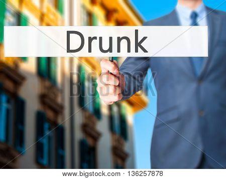 Drunk - Businessman Hand Holding Sign