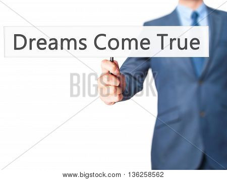 Dreams Come True - Businessman Hand Holding Sign