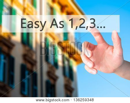 Easy As 1,2,3... - Hand Pressing A Button On Blurred Background Concept On Visual Screen.