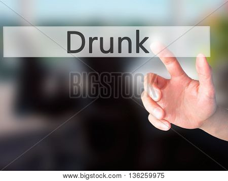 Drunk - Hand Pressing A Button On Blurred Background Concept On Visual Screen.
