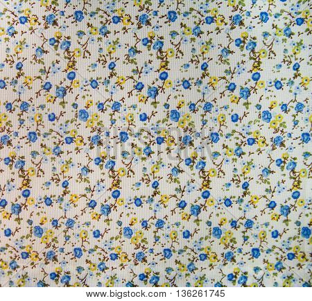 Cotton print coarse weave with a pattern of small flowers - blue and yellow