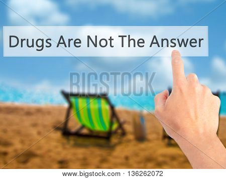 Drugs Are Not The Answer - Hand Pressing A Button On Blurred Background Concept On Visual Screen.