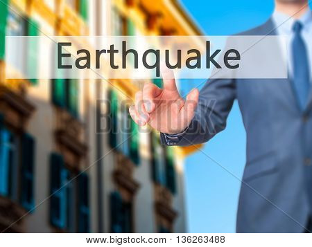 Earthquake - Businessman Hand Pressing Button On Touch Screen Interface.