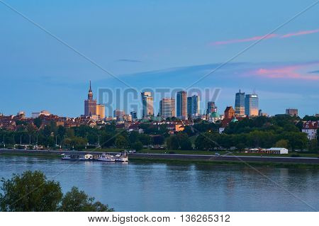 Warsaw, Poland - May 25, 2016: Sunset in the center of City with skyscrapers and historical old town