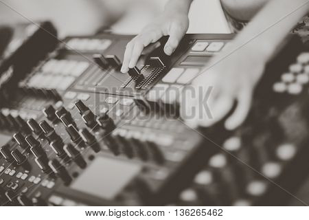 DJ mixing music on console at the club
