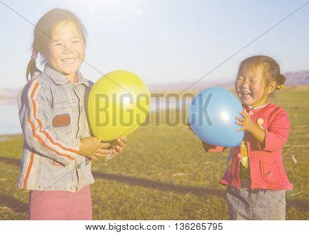 Asian Girls Playing Lake Concept