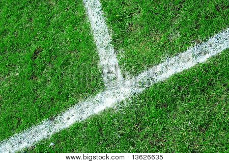 Picture of a football field focused on the touchline