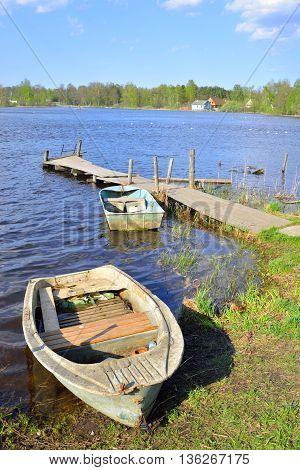 Fishing boats and pier on the Lake Vuoksa the Karelian Isthmus.