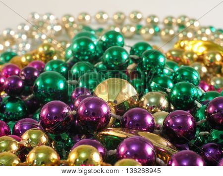 Macro photography of mardi gras beads gathered along different parades!