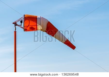 A wind indicator wind sock at an airport