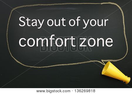 megaphone and speech bubble with text stay out from your comfort zone