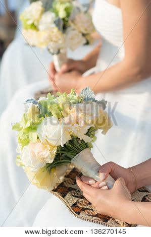 bouquets in females hand mixed florals boquet.