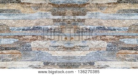 Stone texture background, grainy stone cladding. horizontal.