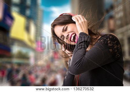 Woman listening to music on the city