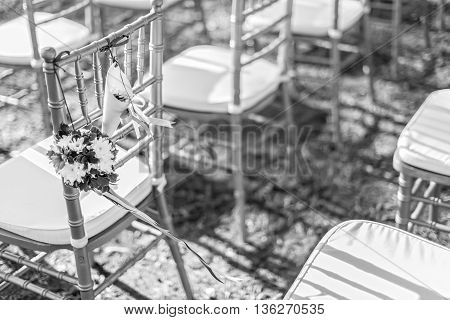 wedding decorations and arrangement flowers chairs ribbon in black and white. selective focus.