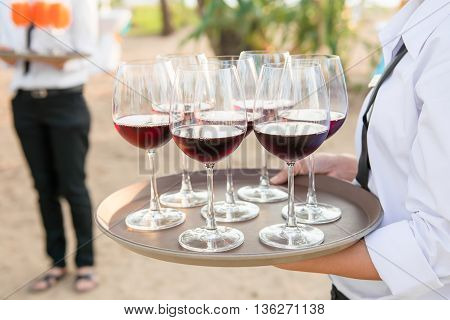 Glasses of wine serving at beach side events.