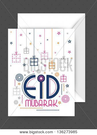 Colourful hanging gifts and stars decorated, Greeting Card design with Envelope for Islamic Holy Festival, Eid Mubarak celebration.