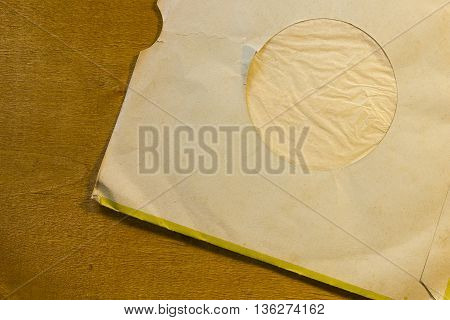 Envelope for vinyl phonograph record on a wooden background