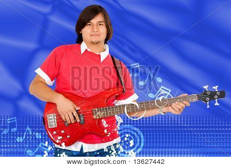 Male guitarist playing over a blue musical background