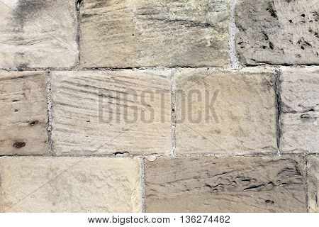 Textured old stone wall background on a church.