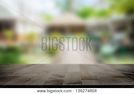 Selected focus empty brown wooden table and Coffee shop blur background with bokeh image for product display montage.