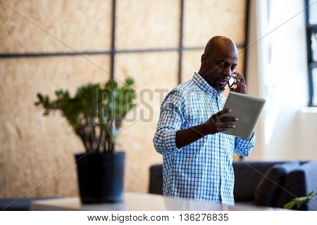Serious man having a phone call in modern office