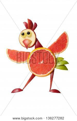 Chicken made of fresh fruits in funny pose